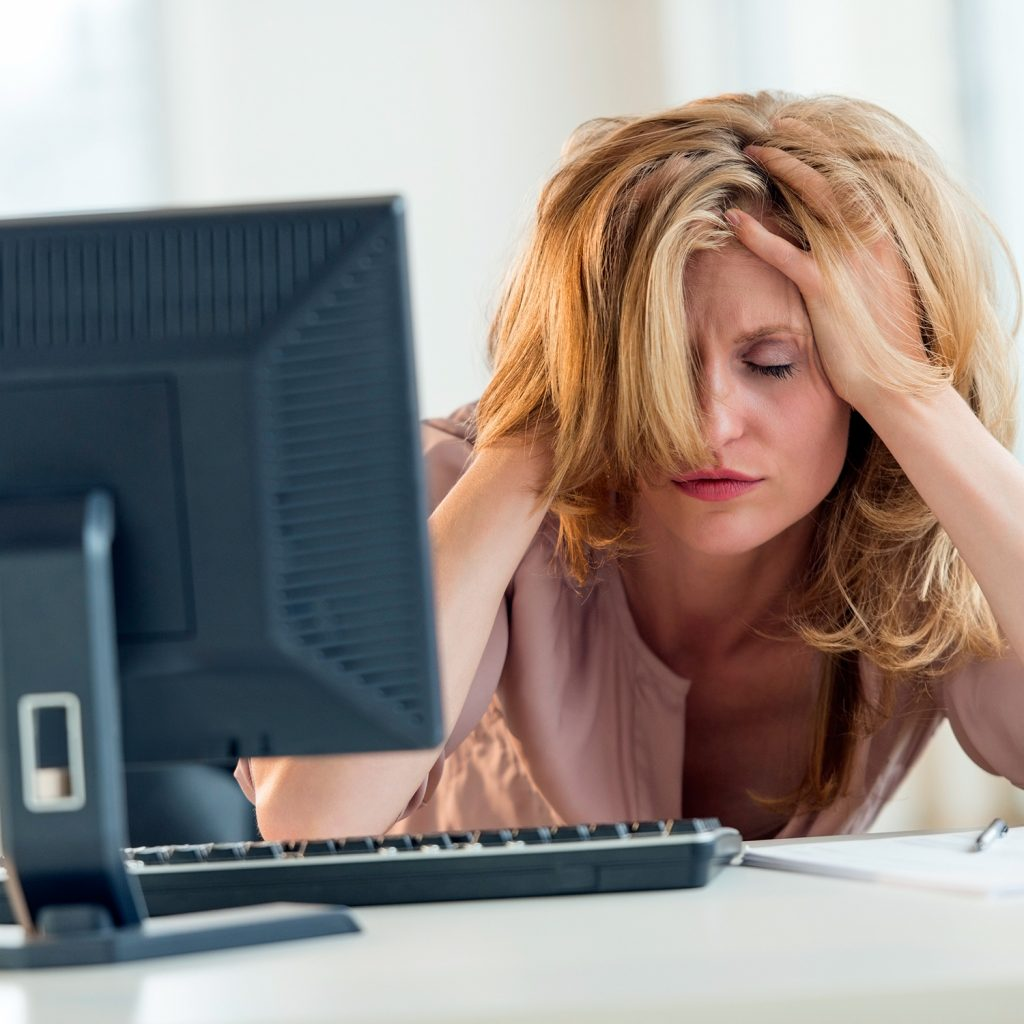 businesswoman-work-computer-hair-stress